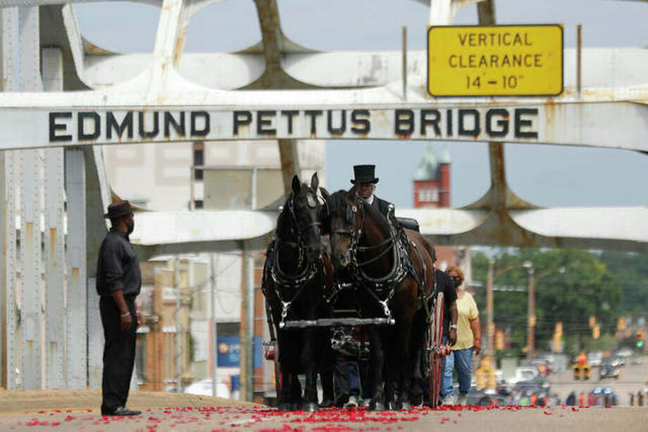 The casket of Rep. John Lewis moves over the Edmund Pettus Bridge by horsedrawn carriage during a memorial service Sunday in Selma, Alabama. Lewis, who carried the struggle against racial discrimination from Southern battlegrounds of the 1960s to the halls of Congress, died July 17. Photo: Brynn Anderson | AP