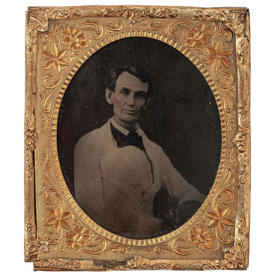 A tintype of Abraham Lincoln wearing a white suit and beardless sold at action for $18,750 to a private collector. Photo: Courtesy Cowan's Auction