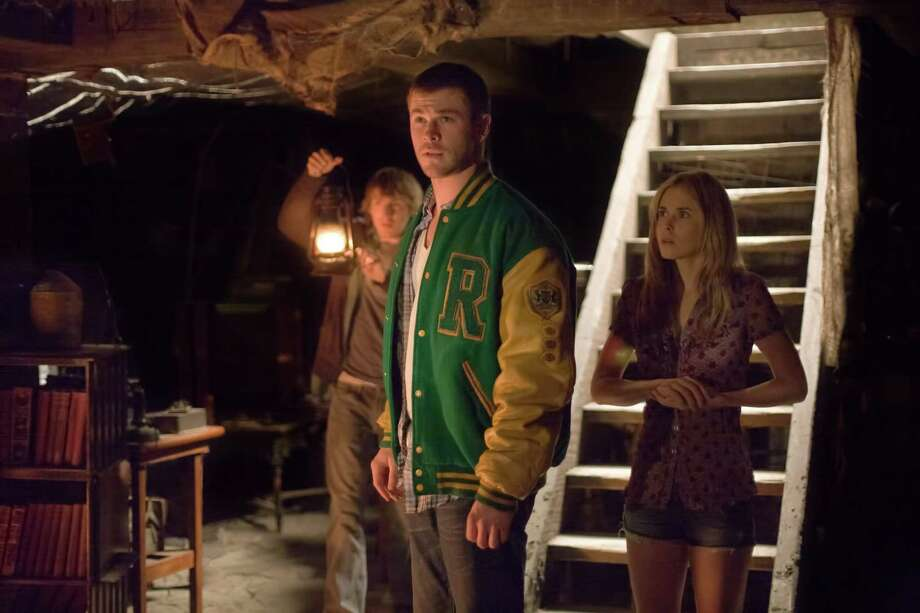 Fran Kranz, Chris Hemsworth and Anna Hutchison are young adults in trouble in 'The Cabin in the Woods' Photo: Photo Credit: Diyah Pera / Photos By Alan Markfield