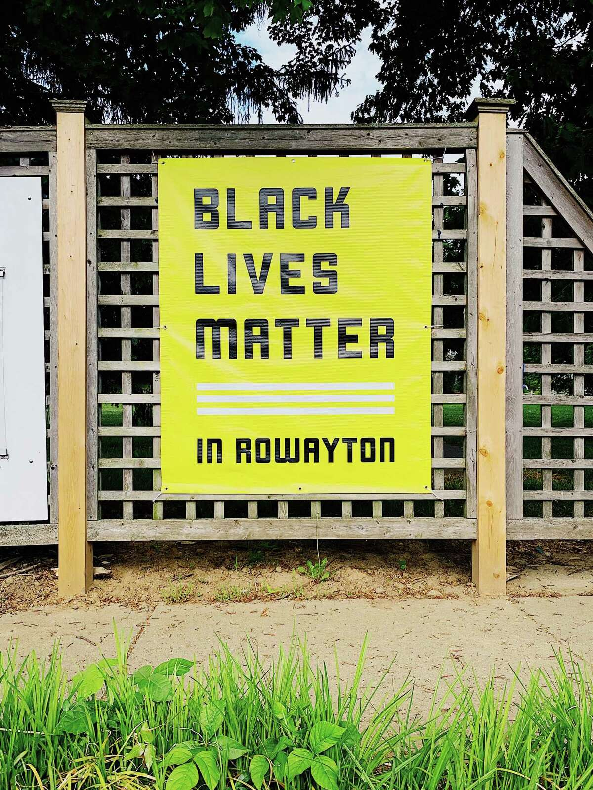 After twice being vandalized, a third banner was placed on the Old School Field fence in Rowayton. But the Sixth Taxing District commissioners said the banner must be removed because it supports a