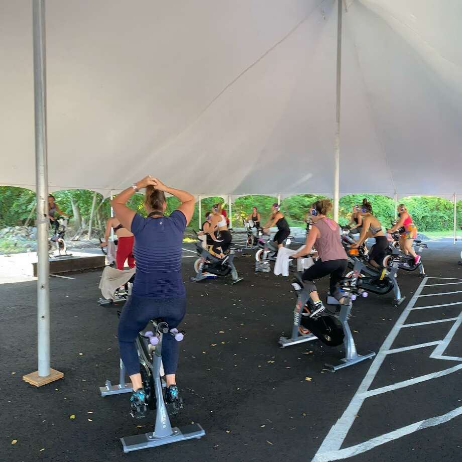 Joyride is partnering with The Corbin District to offer outdoor cycling classes under a tent in Darien. Photo: The Corbin District