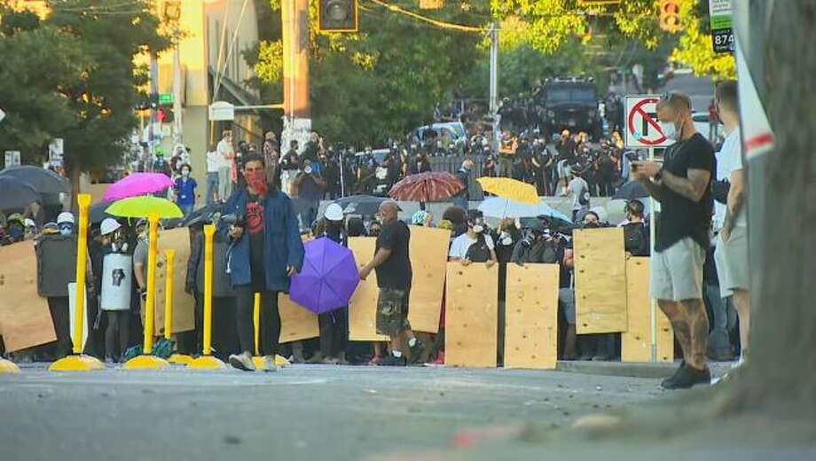Protesters line up on Capitol Hill on July 26, 2020. Photo: Courtesy Of KOMO News
