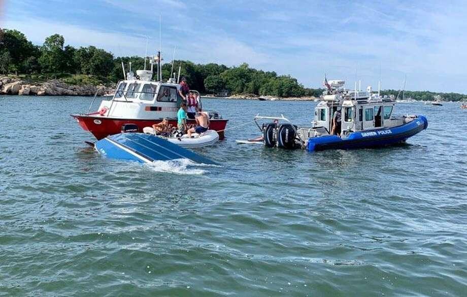 A sinking boat needed aid in Darien's Ziegler's Cove on Sunday. Photo: John Sini / Contributed Photo