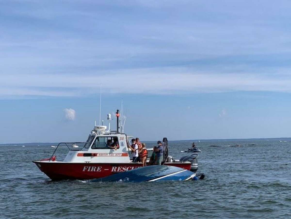 A sinking boat needed aid in Darien's Ziegler's Cove on Sunday.