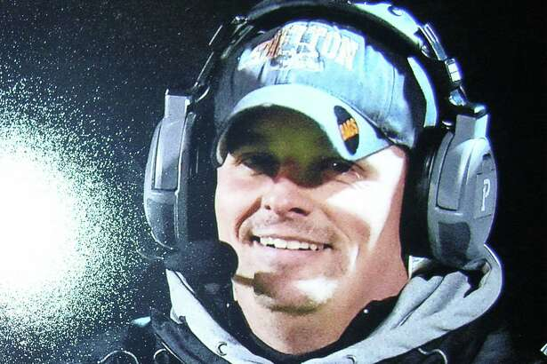 Shelton High School offensive coordinator Michael DeFelice takes a break from the action recently.