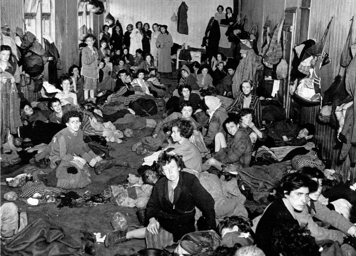 Female inmates at Bergen-Belsen concentration camp, many of them sick and dying of typhus and starvation, wait inside a barrack, in this file photo from April 1945, after British troops liberated the camp. Also suffering from disease there was Anna Zetko, now Dobnik, who held on long enough to be freed, to get medical care and live her life.(AP Photo, File) Ran on: 05-28-2006 Female inmates at Bergen-Belsen, many dying of typhus or starvation, wait in a barrack after British troops liberated the camp.