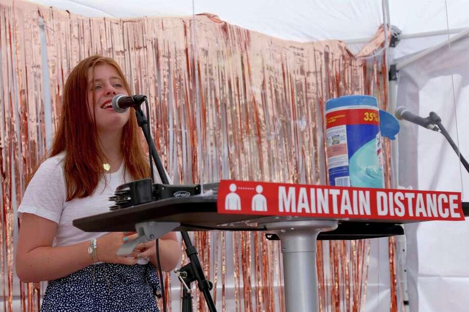 Ayla Nahmias, 14, of Westport, sings at the Triple Threat Academy pop-up performance outside Savvy + Grace on Main Street on Saturday, July 25, 2020, in Westport, Conn. Photo: Jarret Liotta / Jarret Liotta / ©Jarret Liotta 2020