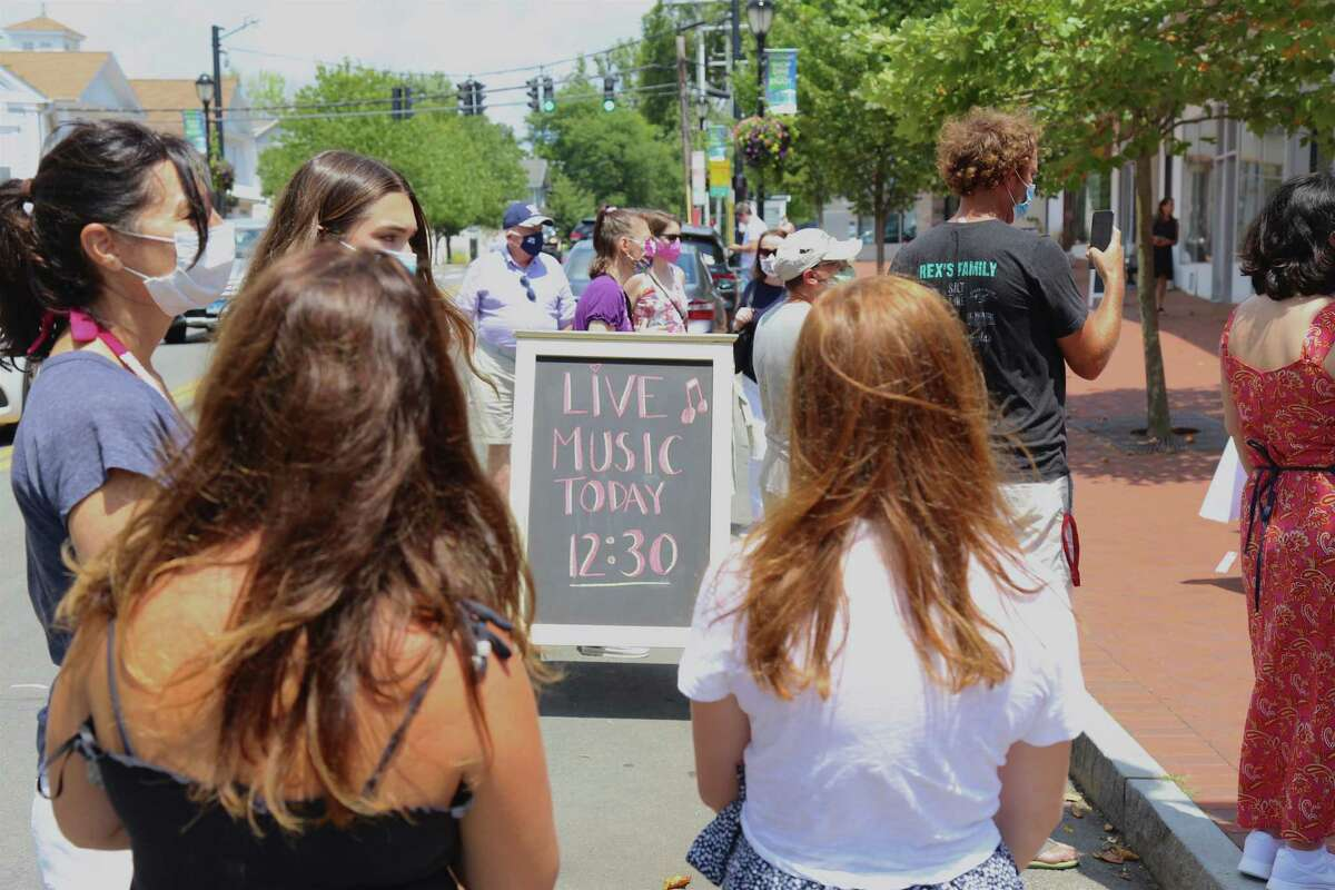 Free live music was to be had at the Triple Threat Academy pop-up performance outside Savvy + Grace on Main Street on Saturday, July 25, 2020, in Westport, Conn.