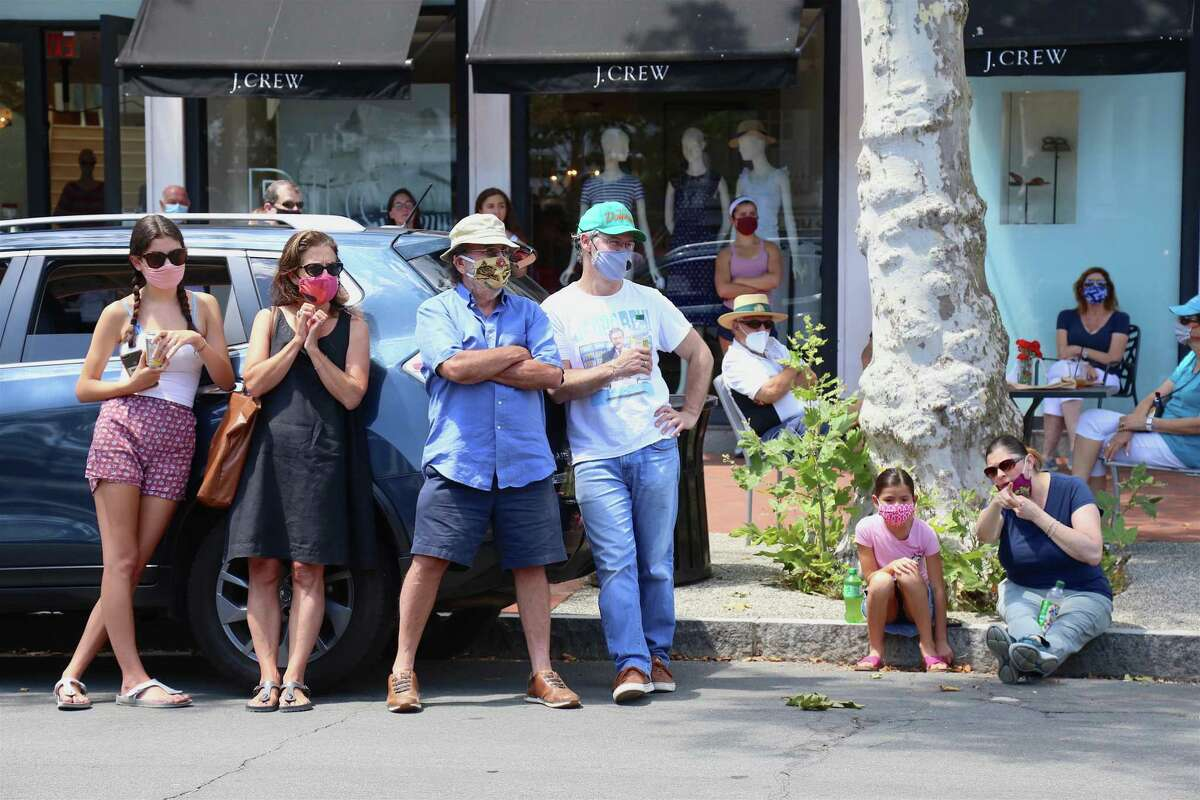 People gathered across Main Street to watch the show at the Triple Threat Academy pop-up performance outside Savvy + Grace on Main Street on Saturday, July 25, 2020, in Westport, Conn.