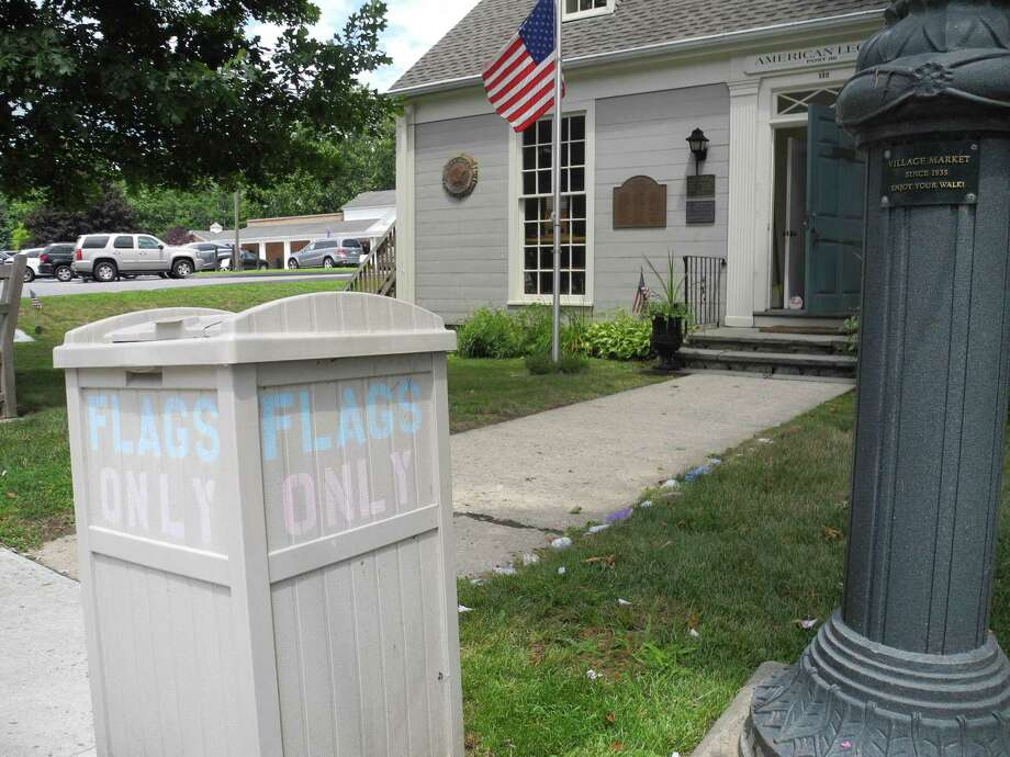 This box, in front of American Legion Post 86 on Old Ridgefield Road is for the disposal of worn or damaged American flags. According to letter writer Tom Moore, some people have been using it to dispose of trash, defiling the flags within. Photo: Jeannette Ross / Hearst Connecticut Media / Wilton Bulletin