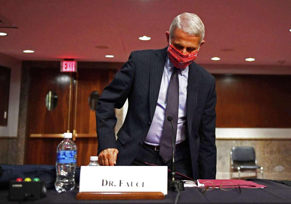 Dr. Anthony Fauci, director of the National Institute for Allergy and Infectious Diseases, prepares to leave after testifying before the Senate Health, Education, Labor and Pensions (HELP) Committee on Capitol Hill in Washington, DC, June 30, 2020. (Photo by KEVIN DIETSCH / POOL / AFP) (Photo by KEVIN DIETSCH/POOL/AFP via Getty Images)