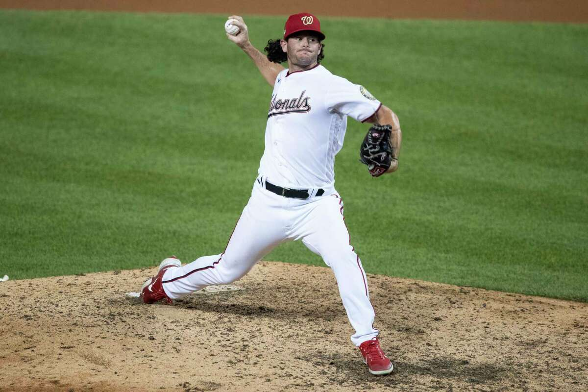 Washington Nationals relief pitcher Kyle Finnegan throws during the ninth inning of a baseball game against the New York Yankees at Nationals Park, Saturday, July 25, 2020, in Washington. (AP Photo/Alex Brandon)