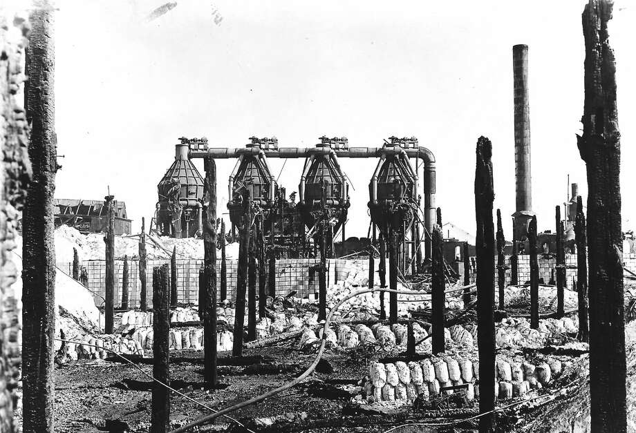 A view of the ruins of the Buckley & Douglas fire with the four evaporations still left standing surrounded by salt. (Courtesy photo/Manistee County Historical Museum) Photo: Manistee County Historical Museum
