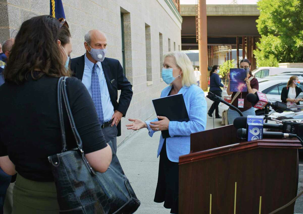 Senator Kirsten Gillibrand, right, talks with Unity House CEO Chris Burke following a press conference on Monday, July 27, 2020, in Troy, N.Y. Senator Gillibrand held the press conference to call For a $50 billion child care stabilization fund to support providers struggling to stay open due to the COVID-19 crisis. (Paul Buckowski/Times Union)