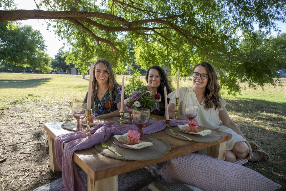 Maci Gregory, left, her sister, Tayler Williams, right, and their mother, Tanya Williams, are owners of Picnics in the Basin.