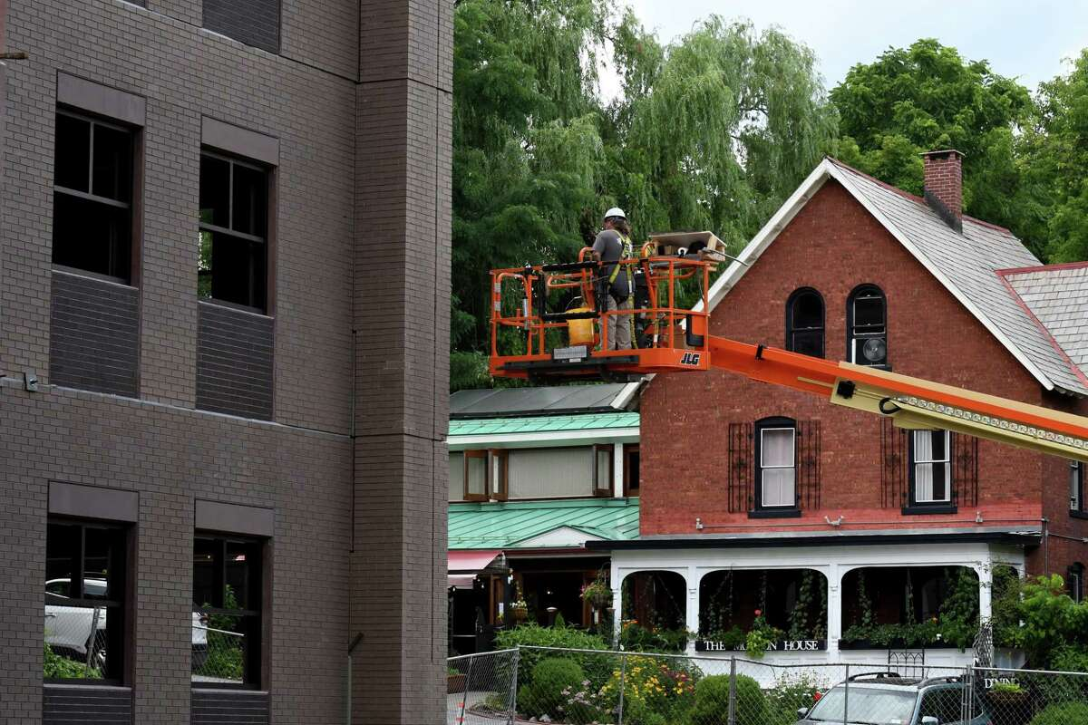 The Mouzon House restaurant is seen the ground floor od Saratoga's new parking garage on High Rock Avenue on Thursday, July 23, 2020, in Saratoga Springs, N.Y. (Will Waldron/Times Union)
