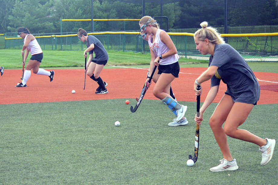 Edwardsville field hockey players practice on Monday morning on the JV baseball turf field at the District 7 Sports Complex,