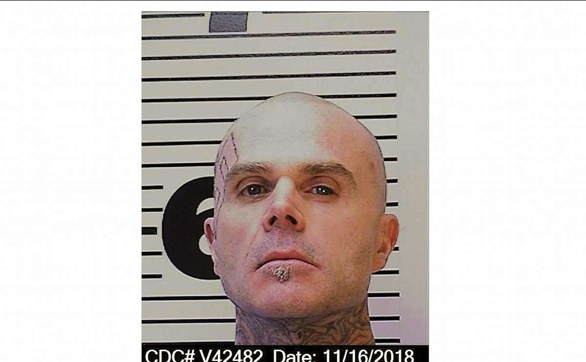 This Nov. 16, 2018, photo released by the California Department of Corrections and Rehabilitation shows death row inmate Todd Givens. Authorities say Givens, a white supremacist gang member on California's death row, is under investigation for slashing a guard the morning of Thursday, July 16, 2020, as the correctional officer was picking up food trays at San Quentin State Prison in Calif. The guard's hand was cut and he needed five stitches. (California Department of Corrections and Rehabilitation via AP)