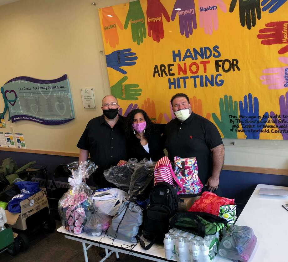 Members of The Crew dropping off items at the Center for Family Justice pictured are Fred Garrity, Jr., CFJ's Youth Trauma Specialist and Camp HOPE Coordinator Sasha Collins and Jay Piccirillo of Micalizzi Italain Ice. Photo: Contributed Photo