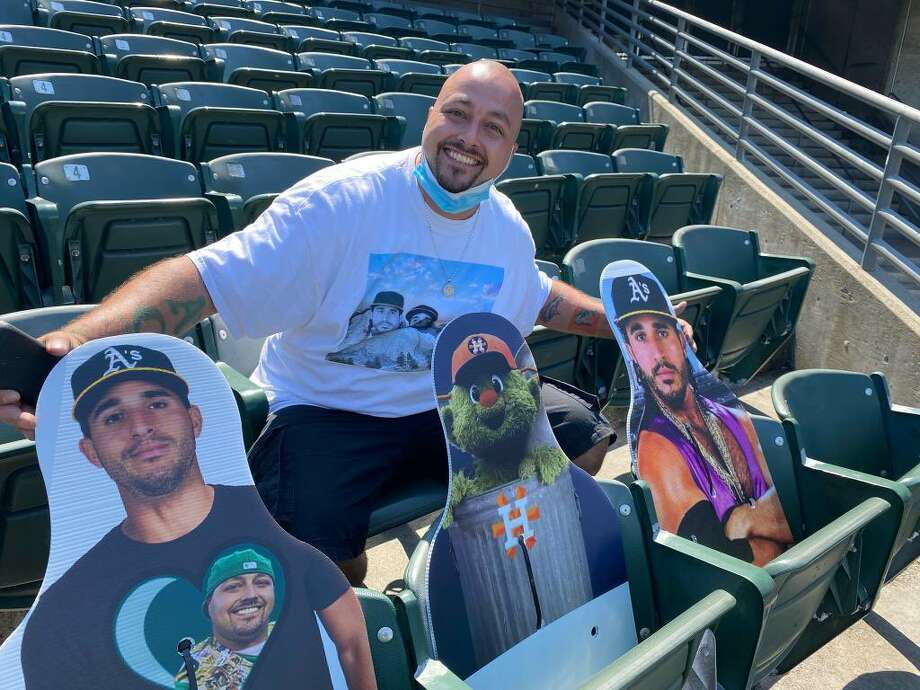 Oakland A's fan Bryan Johansen poses with the three cardboard cutouts he placed in the stands at the Oakland Colisuem. Photo: Bryan Johansen