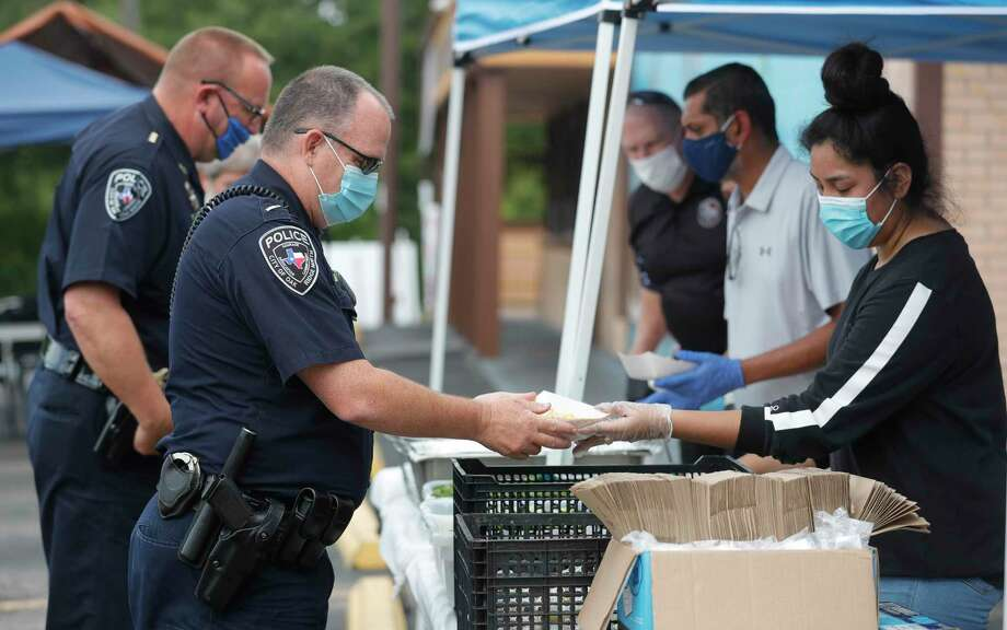 Oak Ridge North Lt. Doug Barry receives a plate of tacos at Joe's Italian Restaurant, Monday, July 27, 2020, in Conroe. Elite Hospitality and PR's Barbecue partnered to feed 2,000 health care workers, law enforcement and other first responders. Photo: Jason Fochtman