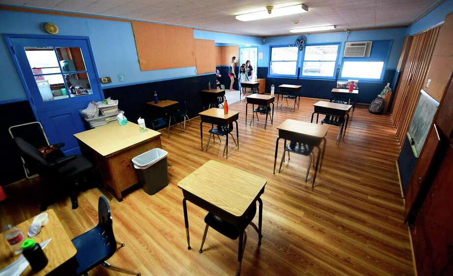 Wilton kindergarten classrooms are not set up with desks like this for social distancing. Classroom furniture, at a cost of about $40,000, is on the district's shopping list. Photo: Frederic J. Brown / Getty Images / AFP or licensors