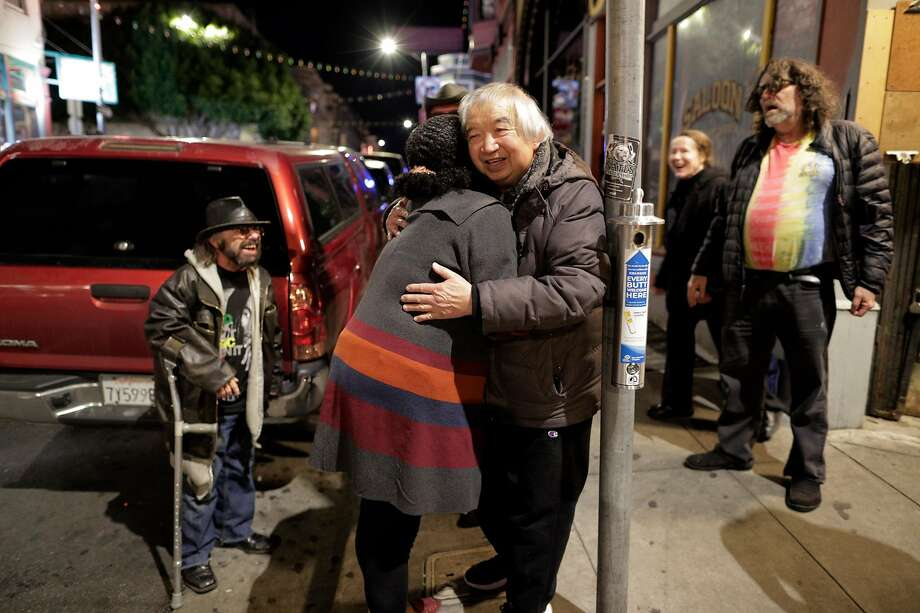Myron Mu gets a hug from Yvette Bates at The Saloon which Mu owns, after closing as the city began to shut down following an order to shelter in place in San Francisco, Calif., on Monday, March 16, 2020. The six Bay Area counties issued a shelter in place order for residents to try and curtail the spread of the Covid-19 virus. Photo: Carlos Avila Gonzalez / The Chronicle