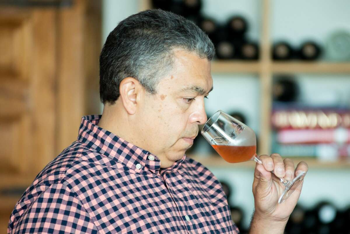 Noel Diaz, wine maker of Purity Wines, smelling a glass of wine on July 24, 2020 in Richmond, Calif.
