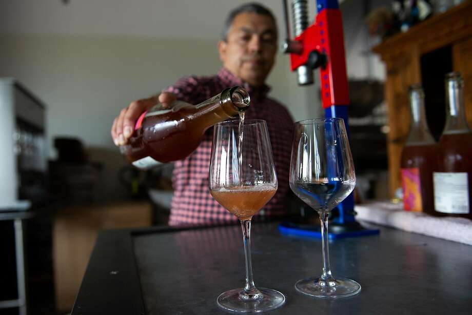 Noel Diaz operates a tasting room out of his Richmond winery. He calls the lounge the Study, and pours other winemakers' wines too. Photo: Kate Munsch / Special To The Chronicle