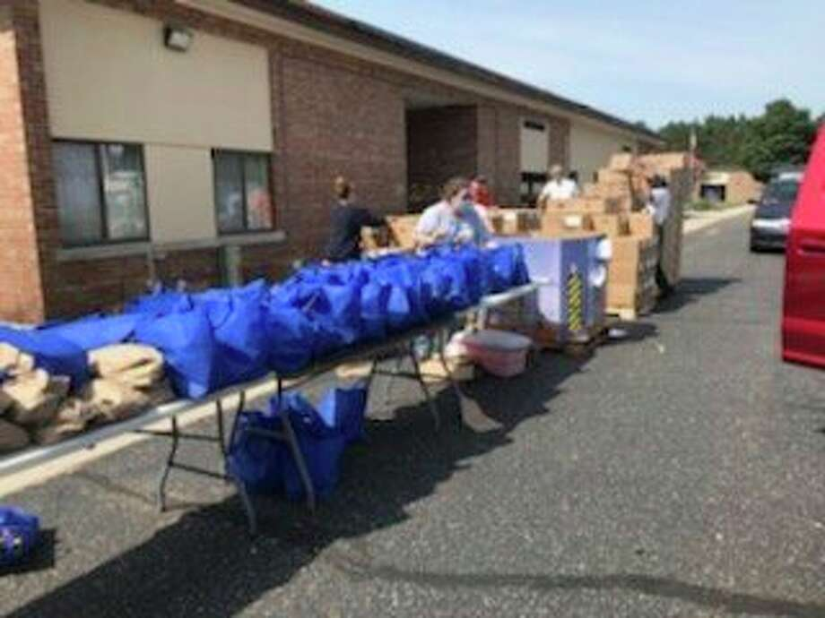 TheFeeding America Food Truck distributed 13,300 pounds of food in Brethren on Saturday. Another event is slated for noon on July 29the former Wellston Elementary School, located at17345 Sixth St., Wellston. (Courtesy photo)