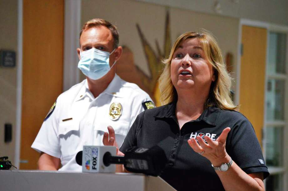 Regional coordinator for Families Against Narcotics, Lori Ziolkowski, talks about the launch of the Comeback Quick Response Team program in the cities of Midland and Saginaw, at a press conference on Monday, July 27, at the Law Enforcement Center in Midland. (Ashley Schafer/Ashley.schafer@hearstnp.com)