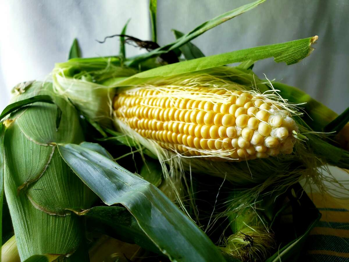 While it's tempting to shuck corn right at the farm stand to see if it's good, there are other ways.