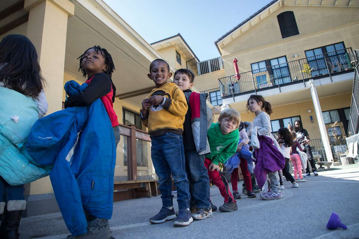 Five-year-olds, Jace Ross, Thomas Elias, Esteban Alfaro, Patrick Kearney and Francesca Altmin at the Holy Family Day Home on Tuesday, Feb. 27, 2018 in San Francisco, CA. If the child care ballot measure passes, it would help families pay tuition at centers like this one.