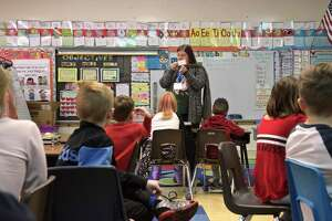 Spanish teacher Gabriella Intemann teaches a class at Huckleberry Hill Elementary School on Wednesday, February 27, 2019. Brookfield, Conn. Intemann wheels a cart with her supply's from classroom to classroom.