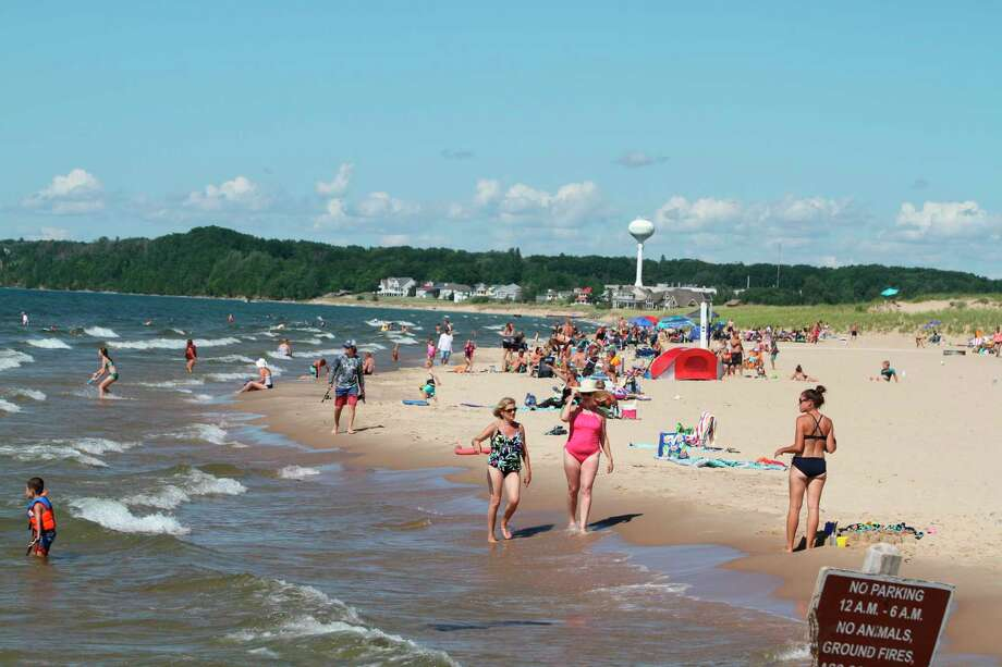 A perfect summer afternoon saw plenty of beachgoers enjoying First Street and Fifth Avenue beaches on Monday. (Kyle Kotecki/News Advocate)