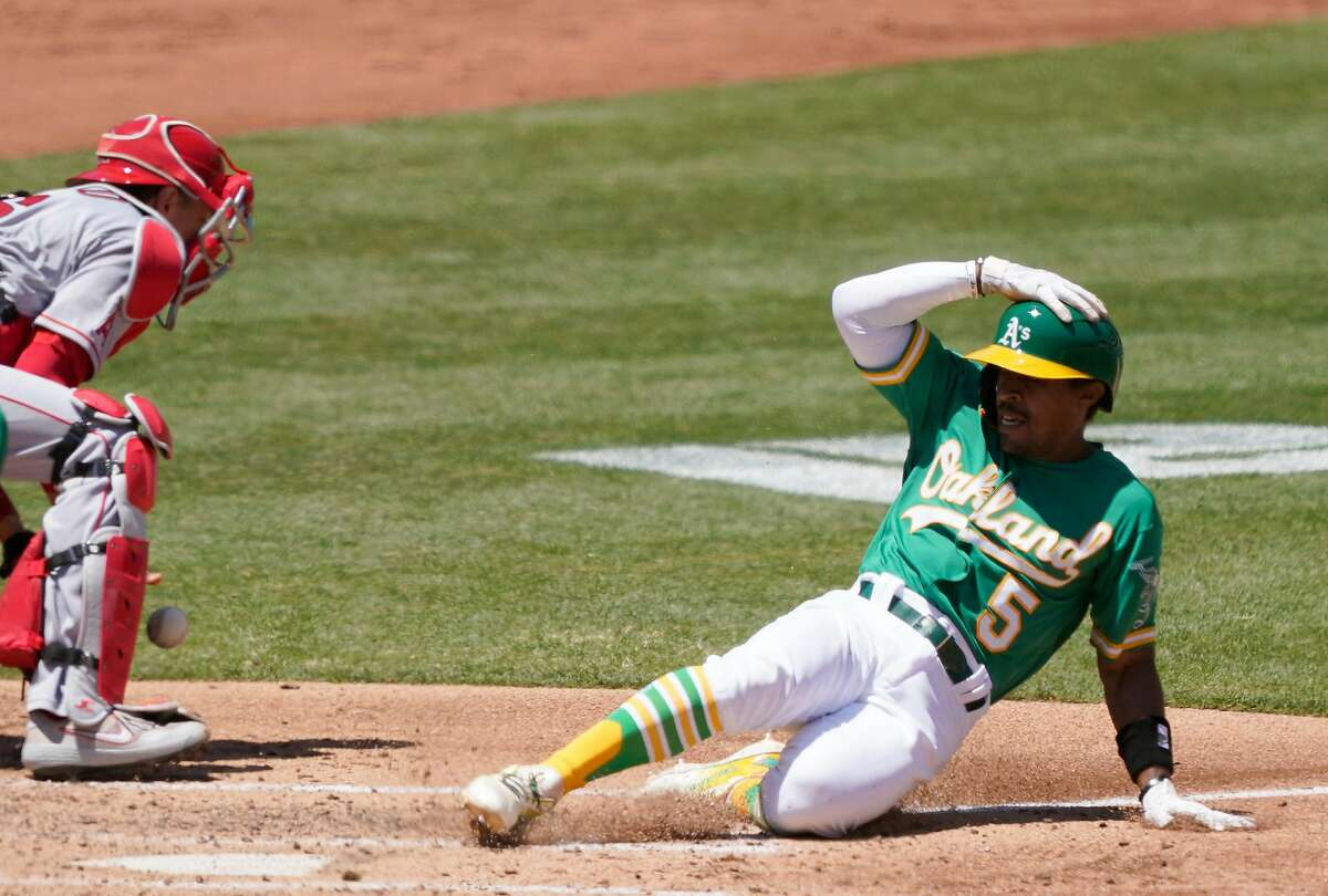 OAKLAND, CALIFORNIA - JULY 27: Tony Kemp #5 of the Oakland Athletics scores against the Los Angeles Angels in the bottom of the third inning at RingCentral Coliseum on July 27, 2020 in Oakland, California. (Photo by Thearon W. Henderson/Getty Images)