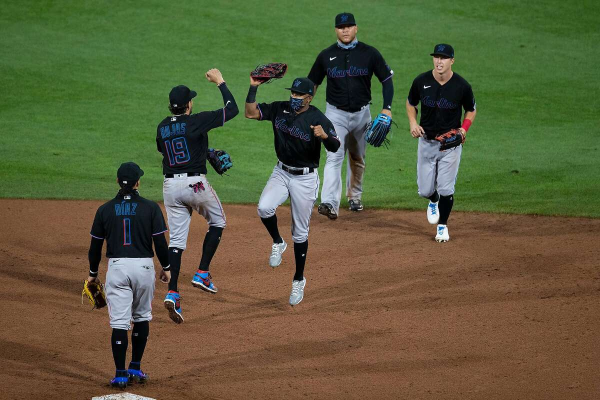 The Miami Marlins celebrate a 5-2 win on Opening Day against the Philadelphia Phillies at Citizens Bank Park on July 24, 2020, in Philadelphia. (Mitchell Leff/Getty Images/TNS)