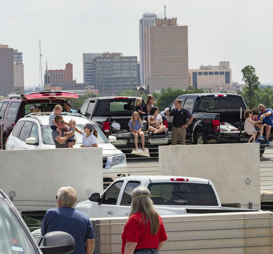 Midlanders wait on the top floor of the Midland Memorial Hospital parking garage May 15 to watch a flyover by a B1B Lancer out of Dyess Air Force Base. Photo: Tim Fischer/Midland Reporter-Telegram