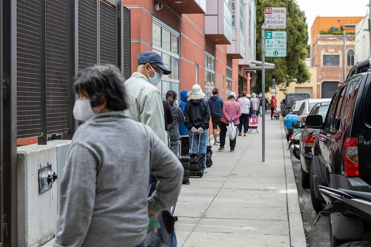 People line up for a San Francisco-Marin Food Bank pop-up pantry on Thursday, July 16, 2020, in San Francisco, CA.