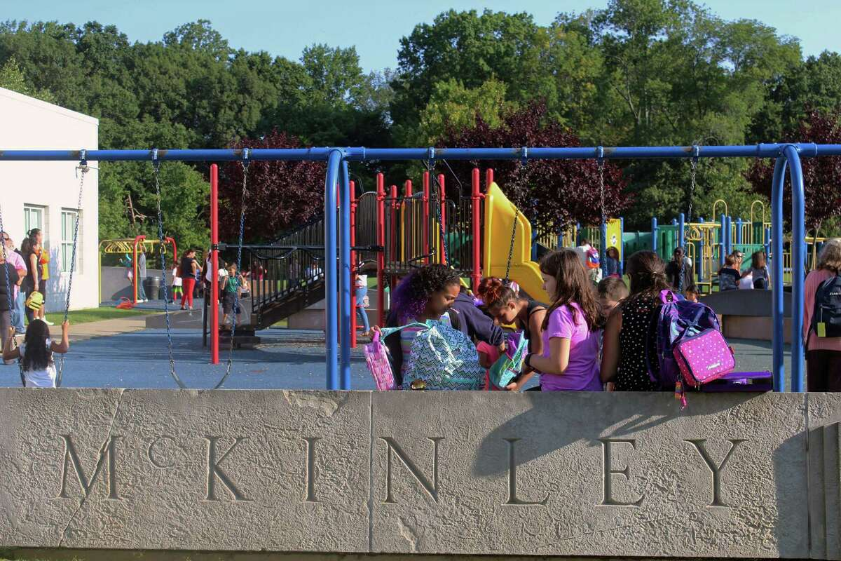 Students at McKinley School hung out at the playground Thursday, the first day of school, while waiting for the bell to ring. Fairfield,CT. 8/31/17