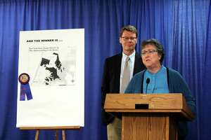 NYPIRG legislative director, Blair Horner, left, and Common Cause/NY executive director, Susan Lerner, right, speak during a news conference where they criticized the statea€™s legislative redistricting process Monday, June 23, 2014, at the Legislative Office Building in Albany N.Y. During the event NYPIRG awarded Senate District 34, chart displayed left, as the most gerrymandered district in the state. (Selby Smith / Special to the Times Union)
