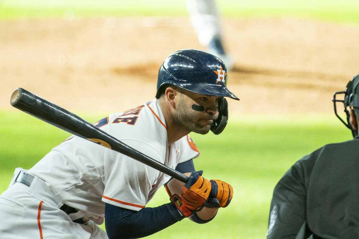Houston Astros second baseman Jose Altuve (27) watches his final strike go by during the first inning of a game between the Houston Astros and Seattle Mariners on Monday, July 27, 2020, at Minute Maid Park in Houston.