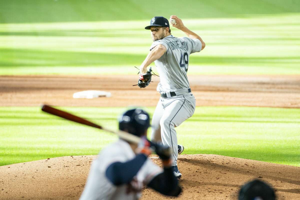 Seattle Mariners starting pitcher Kendall Graveman (49) pitches during the first inning of a game between the Houston Astros and Seattle Mariners on Monday, July 27, 2020, at Minute Maid Park in Houston.