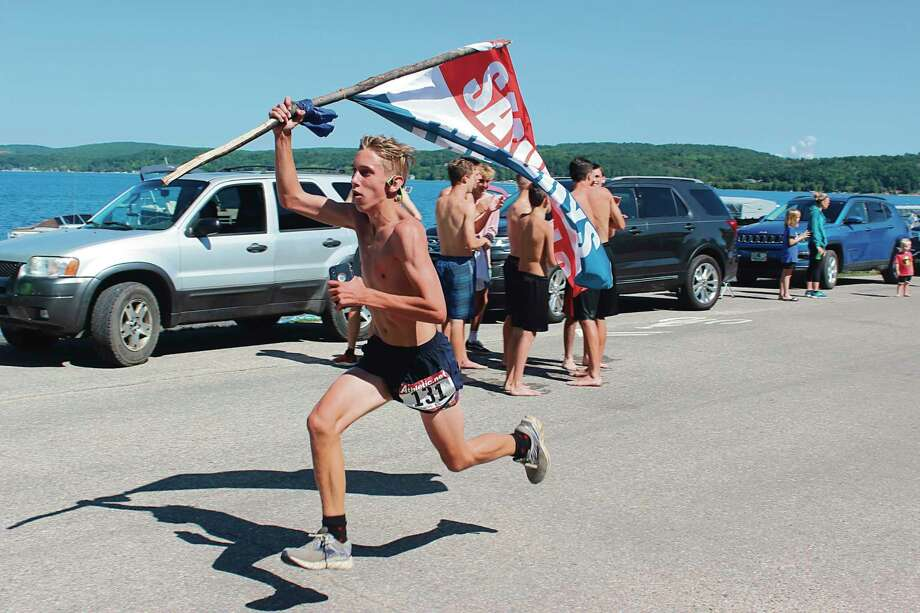 For the past 40 years teams made up of friends, families, or even high school or college teammates have enjoyed racing in the Crystal Lake Team Marathon. (File photo)