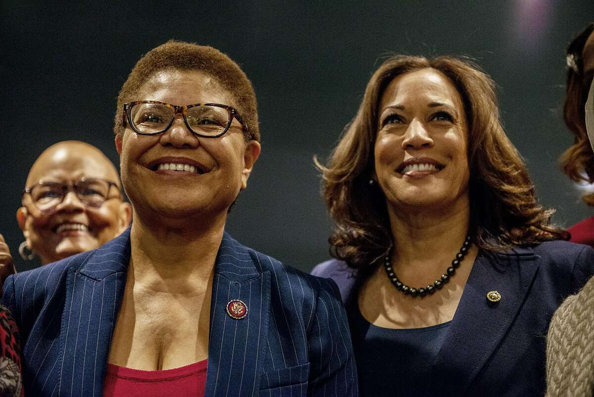 Rep. Karen Bass (left), shown with Sen. Kamala Harris, may be tapped to serve in Biden's Cabinet.