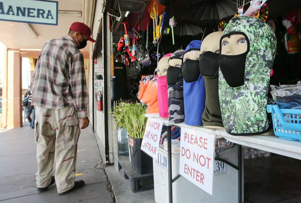 CALEXICO, CALIFORNIA - JULY 24: Face masks are displayed at a shop near the U.S.-Mexico border in Imperial County, which has been hard-hit by the COVID-19 pandemic, on July 24, 2020 in Calexico, California. Unemployment claims in California have reached their highest levels in almost three months with surging coronavirus cases upending plans to reopen the economy. Imperial County currently suffers from the highest death rate and near-highest infection rate from COVID-19 in California. The rural county, which is 85 percent Latino, borders Mexico and Arizona and endures high poverty rates and air pollution while also being medically underserved. In California, Latinos make up about 39 percent of the population but account for 55 percent of confirmed coronavirus cases. (Photo by Mario Tama/Getty Images)