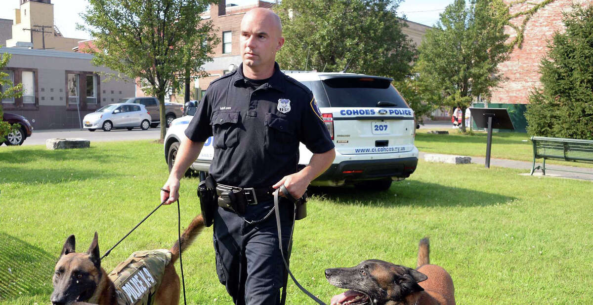 Officer and K-9 handler Sean McKown, with retiring K-9 Jeter, right, and Jeter's son and replacement Loky outside the Cohoes Police Station Wednesday Sept. 9, 2015 in Cohoes, NY. (John Carl D'Annibale / Times Union)