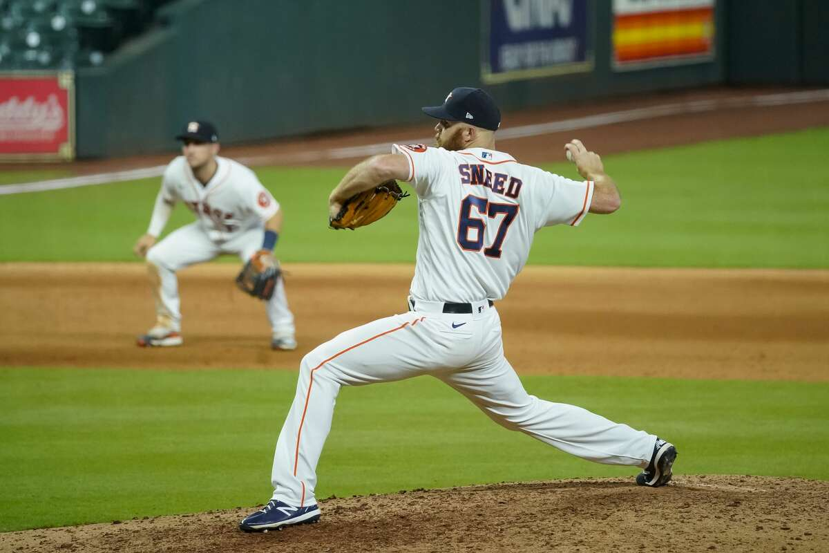 Houston Astros relief pitcher Cy Sneed (67) pitches during the eighth inning of a game between the Houston Astros and Seattle Mariners on Monday, July 27, 2020, at Minute Maid Park in Houston.