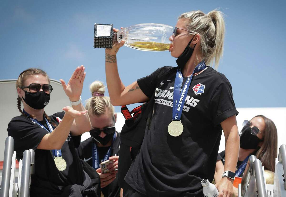 Dash forward Rachel Daly, who took MVP honors at the NWSL Challenge Cup, turned the trophy into a beer glass upon arriving back in Houston with her teammates.