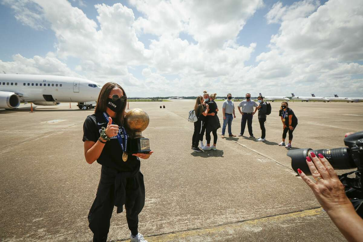 Houston Dash Shea Groom holds her MVP championship trophy after returning home at Atlantic Aviation IAH Monday, July 27, 2020, in Houston.